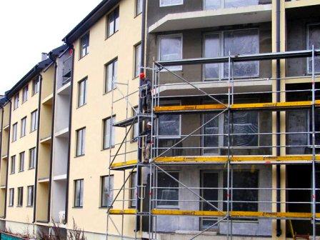 Утепление фасадов многоэтажных домов с лесов