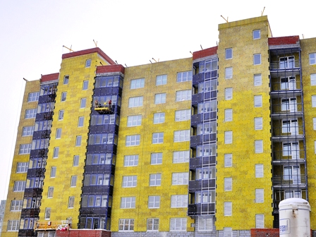 Утепление фасадов многоэтажных домов с люлек